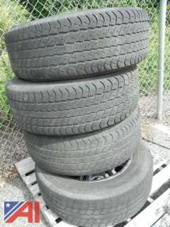 (4) Tires (P275/60R20) and Rims From 1999 GMC Yukon Denali